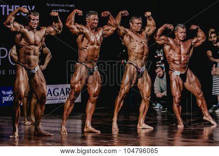 group of men bodybuilder full length
