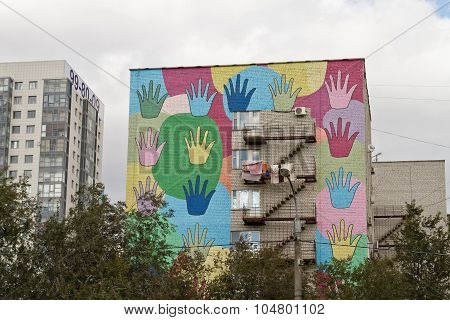Colored Human Palms Painted On Facade Of Building