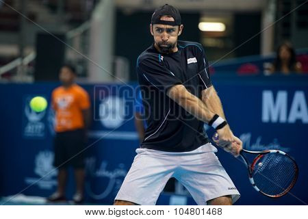 KUALA LUMPUR, MALAYSIA - OCTOBER 03, 2015: Germany's tennis player Benjamin Becker plays a backhand return at the 2015 Malaysian Open tennis tournament from Sep 26 - Oct 4, 2015 in Stadium Putra.