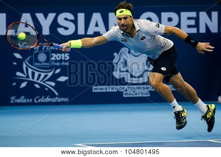 KUALA LUMPUR, MALAYSIA - OCTOBER 03, 2015: Spain's tennis player David Ferrer stretches to make a forehand return at the 2015 Malaysian Open tennis tournament held in the Stadium Putra.