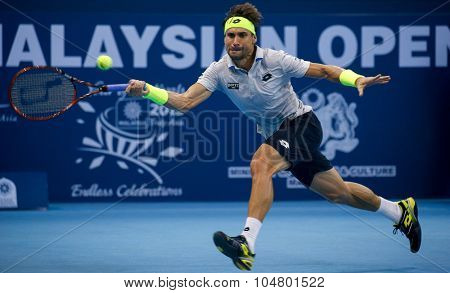 KUALA LUMPUR, MALAYSIA - OCTOBER 03, 2015: Spain's tennis player David Ferrer plays a forehand return at the 2015 Malaysian Open tennis tournament from Sep 26 - Oct 4, 2015 in Stadium Putra.