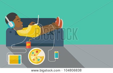 An African American man in glasses and headphones lying on a sofa with electronic devices and fast food vector flat design illustration. Horizontal layout with a text space.