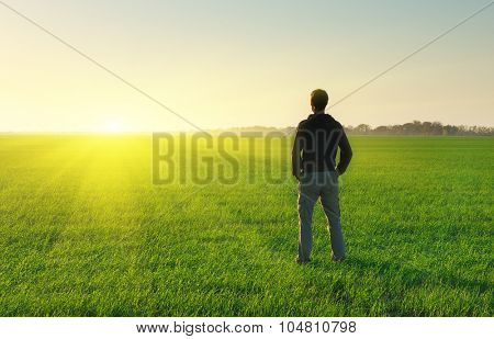 Man in meadow green meadow. Conceptual scene.