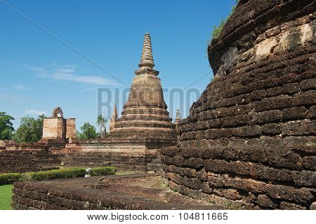 View to the ruins of Wat Mahathat in Sukhothai Historical park Sukhothai, Thailand.