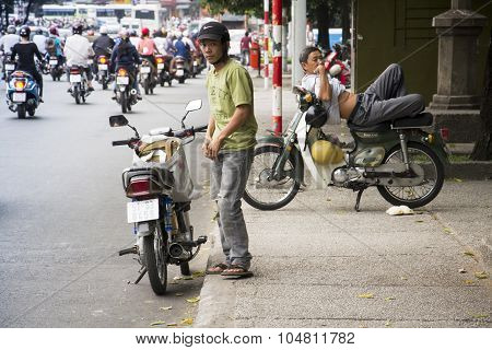 Man Rests On Scooter In Ho Chi Minh City, Vietnam