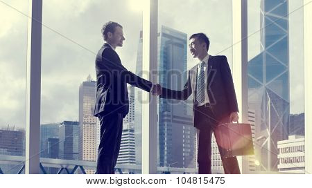 Asian Business Handshake Agreement Partnership Concept