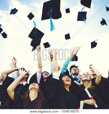 Graduation Caps Thrown Happiness Success Concept