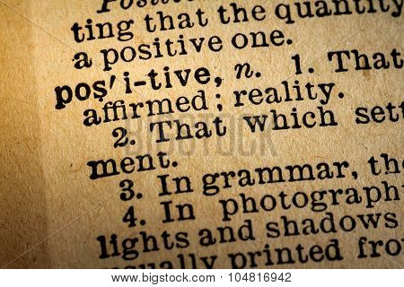 Close-up Of The Word Positive And Its Definition