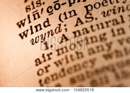Close-up Of An Opened Dictionary Showing The Word Wind