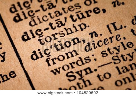 Close-up Of An Opened Dictionary Showing The Word Diction