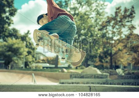 Young Skateboarder Practicing In The Skate Park In New York City