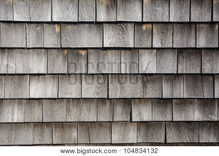rows of wood shingles on barn