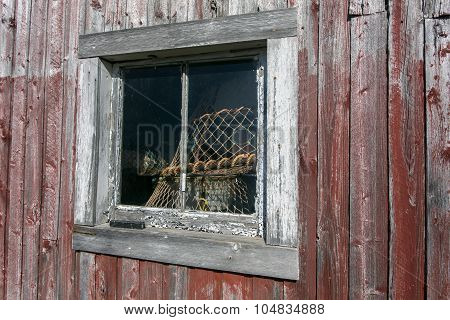 old shed, fish trap in window