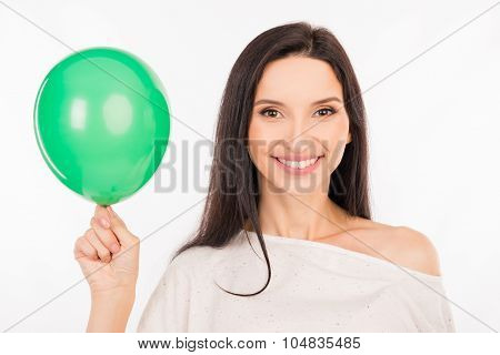 Happy Young Woman Smiling With Green Balloon