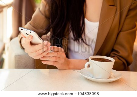 At Dinner Young Woman Reading Messege On Phone In Cafe