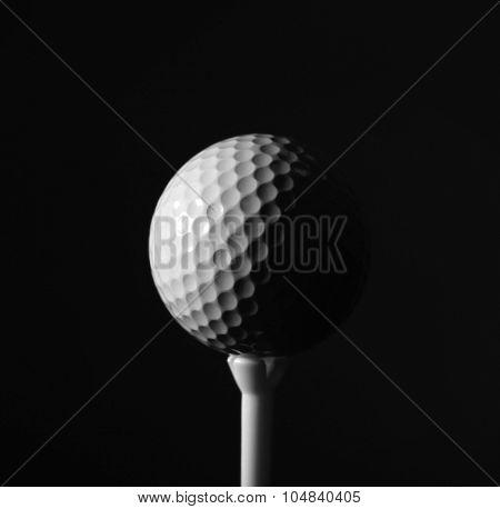 Golf ball on dark background