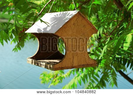Bird feeder house with bird food, outdoor