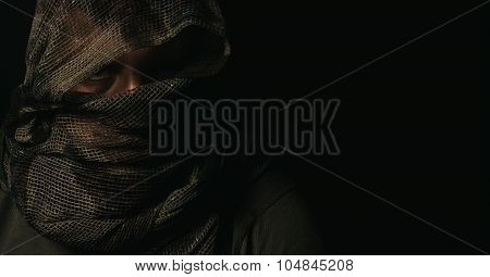 Hide Sniper With Camouflage Scarf Over Head In Front Of Isolated Black Background