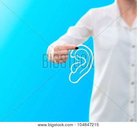 conceptual image of a woman holding a sketch of an ear