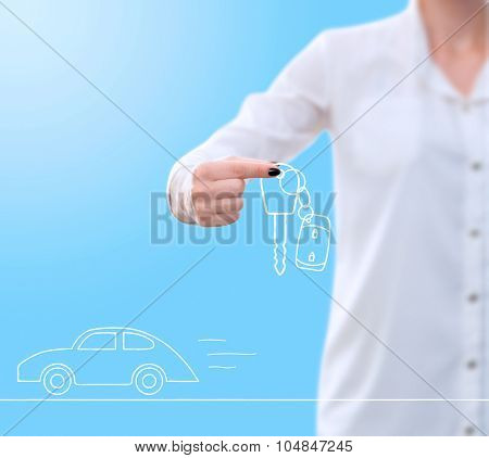 conceptual image , showing a woman's hand holding / giving away a card key drawing while at the same time a car drawing is speeding underneath