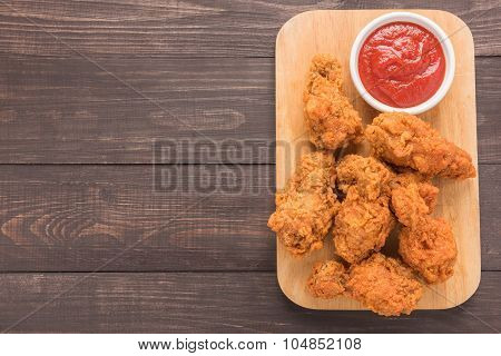 Fried Chicken Drumstick And Ketchup On Wooden Background