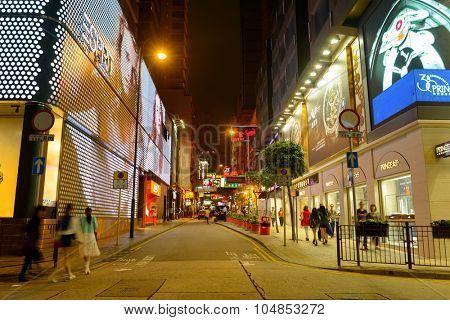 HONG KONG - APRIL 21, 2014: Tsim Sha Tsui streets at night. Tsim Sha Tsui, often abbreviated as TST, is an urban area in southern Kowloon, Hong Kong.