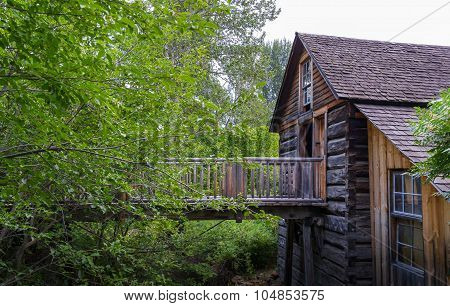old wood building on small river bank
