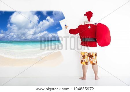Santa Claus With Beachwear And Painting Vacation Concept On Wall