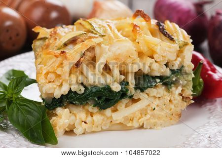 Pasticcio or pastitsio with chard and zucchini, italian baked pasta