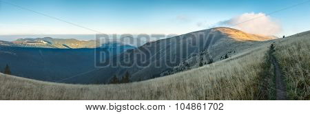Morning On Mountain Ridge Under Blue Sky In Late Summer