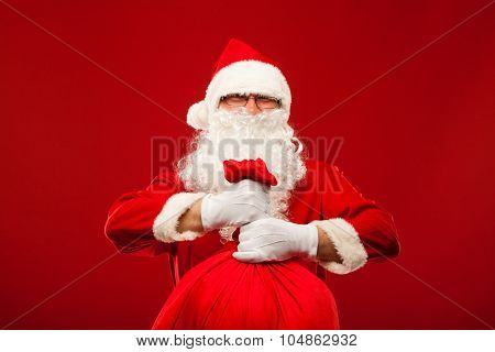 santa claus with big bag on shoulder glasses  red background