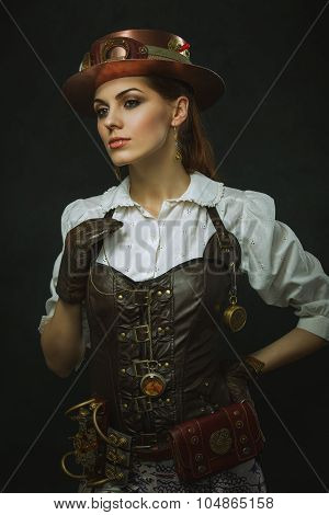 Portrait Of A Beautiful Steampunk Woman Over Dark Background.