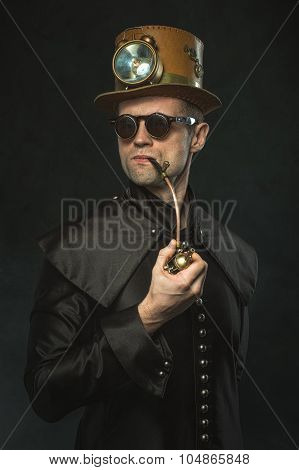 Steampunk Man In A Hat Smoking A Pipe.