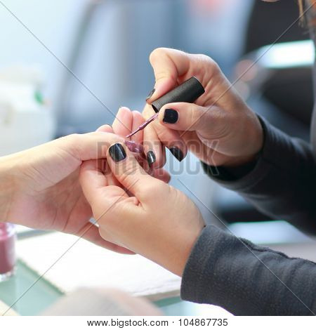 Manicure. Processing of nails by a nail file