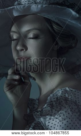 Night Portrait Of A Beautiful Woman With Closed Eyes.