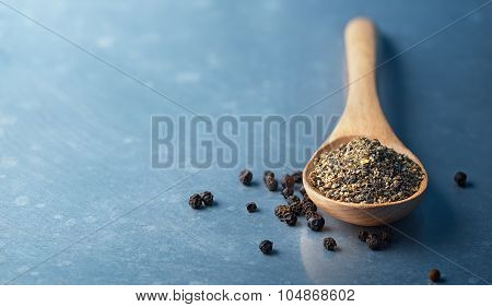 Black Peppercorns And Ground Pepper