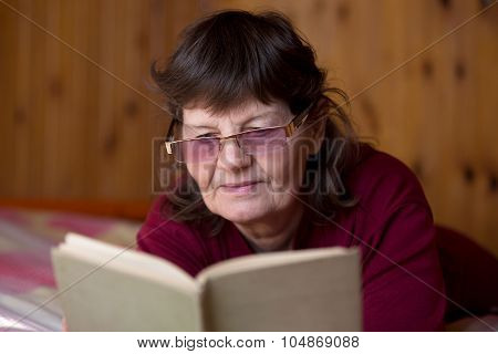 Elder Woman Engrossed In Reading