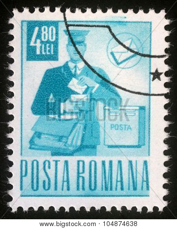 ROMANIA - CIRCA 1971: A stamp printed in Romania shows postman on round, circa 1971.
