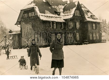 KRYNICA, POLAND, CIRCA 1952: Vintage photo of two women with children in winter