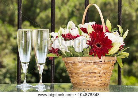 Two Glasses Of Champange And Flower Basket