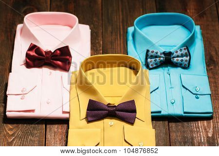 Top View Of Colorful Men's Shirts With  Ties