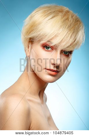 Headshot Of A Beautiful Blonde Girl With Orange Fashion Makeup