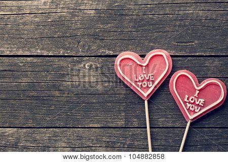 Lollipop heart on a vintage wooden background