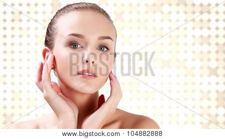 Posh woman against an abstract background with brights round spots