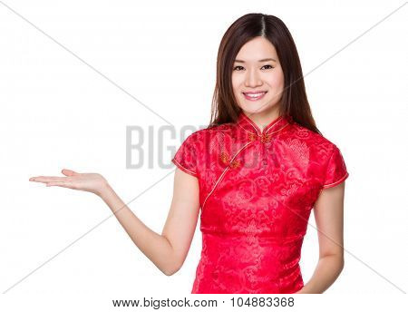 Woman with chinese traditonal costume show with the open hand palm
