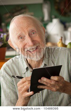 Senior Man With Checkbook