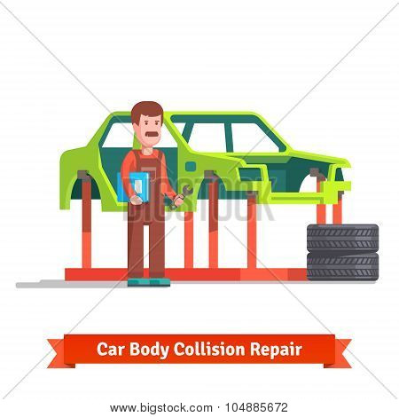 Collision repair center specialist checking car