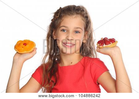 Beautiful girl in a red dress raised her hands up with tasty cakes isolated on white