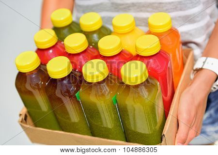 Organic cold-pressed raw vegetable juice plastic bottles. Latest food trend consisting of juicing at high pressure fresh fruits and vegetables without heating to preserve nutrients and vitamins.