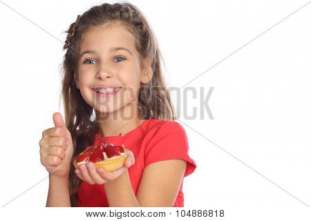 Beautiful girl in a red dress holding a cake with strawberries and raised her thumb up isolated on white